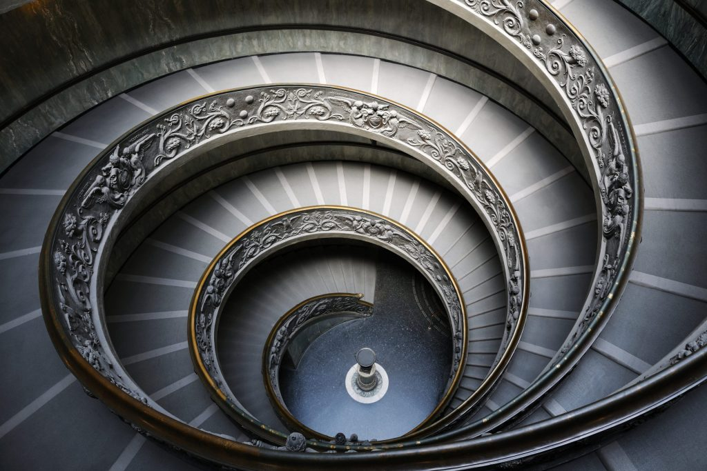 Rome, Italy - June 4, 2011: The old stairway inside the Vatican museum in Rome, Italy
